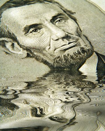 legal tender: Abe in Water Stock Photo