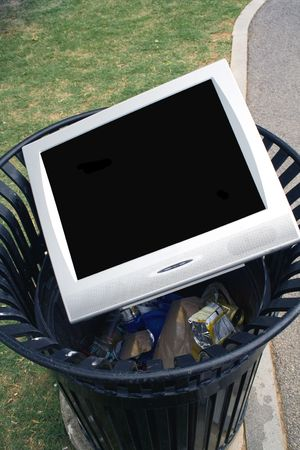 trashy: Television or Monitor laying in a trash can