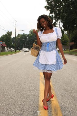 Modern Day Dorothy walking down the yellow lined road