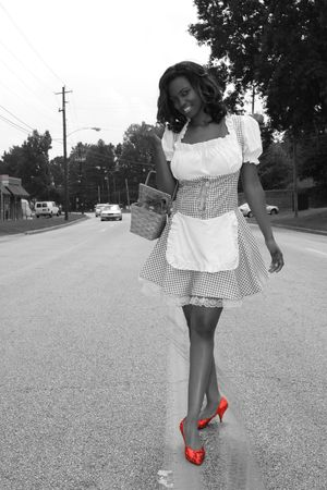 Modern Day Dorothy, desaturated with red ruby shoes