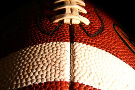 A closeup of an American Football, low key