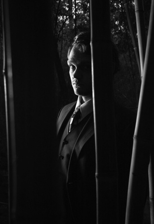 A mysterious man in shadows, black and white photo
