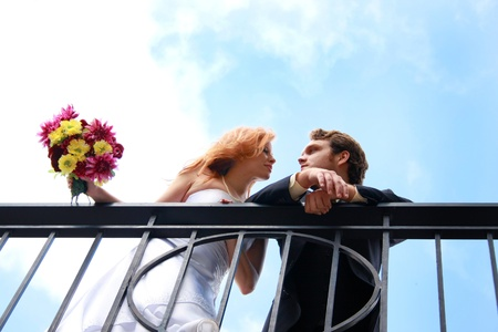 balcony: A bride and groom on a balcony