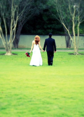 Bride and Groom walking away, cross process, intentional blur