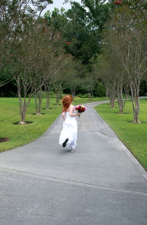escape: A beautiful redheaded bride running away, or rushing late