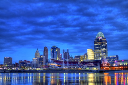 6am Cincinnati Ohio editorial skyline as seen from riverbank of Newport Kentucky