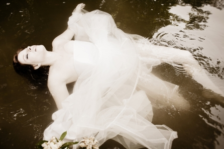 floating on water: A bride floating in the water, asleep or dead