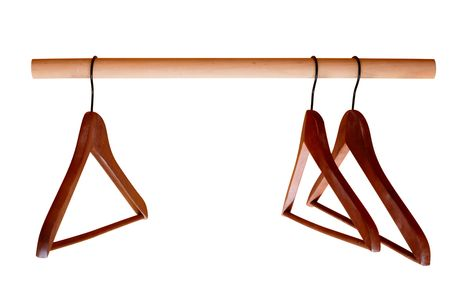 Empty hangers for clothes on rail isolated on white photo