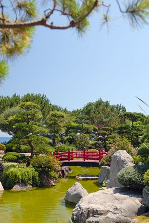 Japanese red bridge in zen garden Stock Photo - 3575226