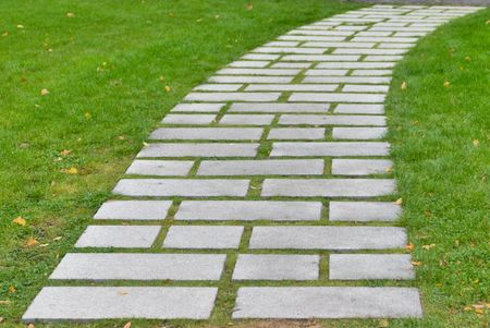 Flagstone walkway on a grassy field photo