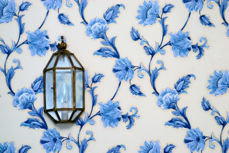 Decorative lamp on vintage wallpaper photo