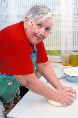 Woman kneading dough Stock Photo