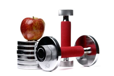 Barbells and apple isolated on white background photo