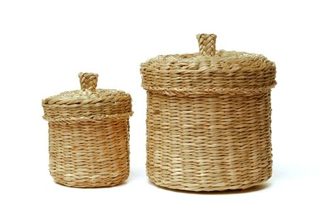 Two wattled baskets isolated on white background photo