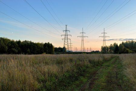 High voltage powerline at rural landscape photo