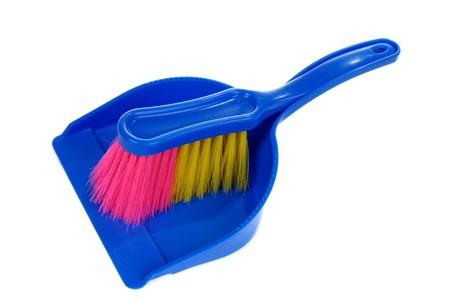 Brush and dustpan isolated on white background photo