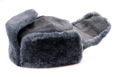 Russian fur hat with ear-flaps isolated on white Stock Photo