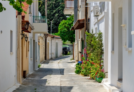 Narrow street in old village Omodos on Cyprus photo