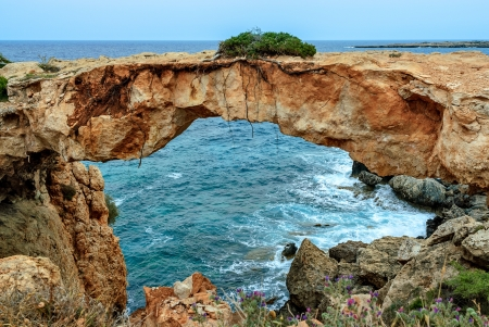 Stone arch over coastline on Cyrpus