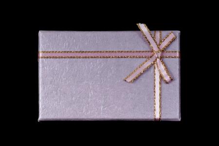 Gift box with ribbon isolated on black background photo