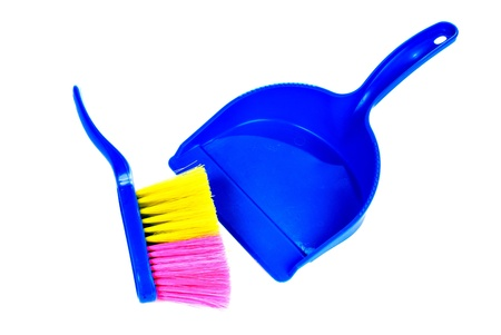 Brush and dustpan isolated on white background photo