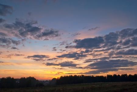 dawning: Sunset over rural landscape Stock Photo