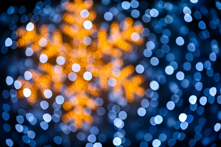 Christmas background whith blurred snowflake and lights photo