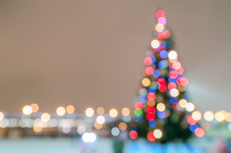 blur effect: Defocused christmas tree silhouette with blurred lights Stock Photo