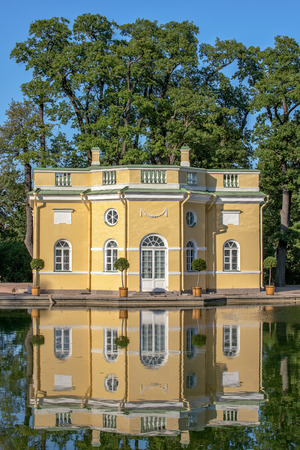 bathhouse: The Upper Bathhouse pavilion with mirror reflection in pond in the Catherine Park. Tsarskoye Selo. Russia Editorial