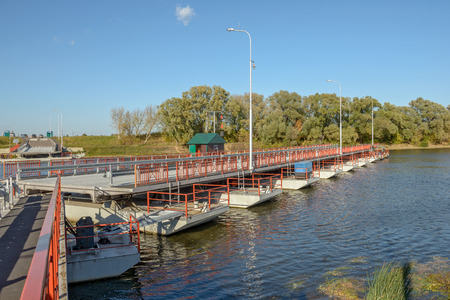 movable bridge: Movable floating bridge through Moscow river in Kolomna town