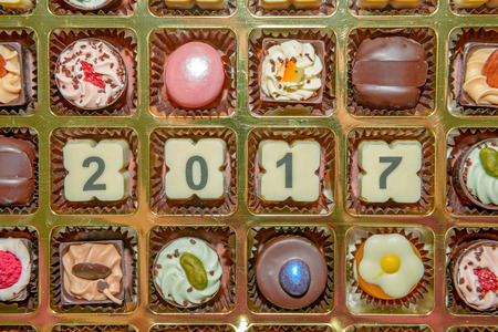 Chocolate sweets and candies with 2017 new year sign Stock Photo