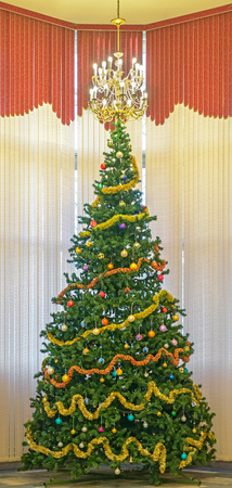 Christmas tree decorated with balls and garlands