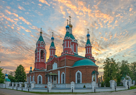 Russian orthodox church over burning sunset