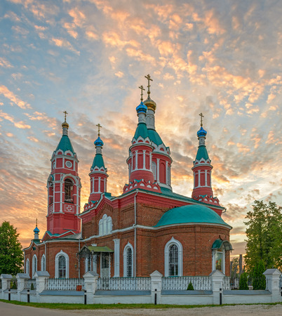 Russian orthodox church over burning sunset