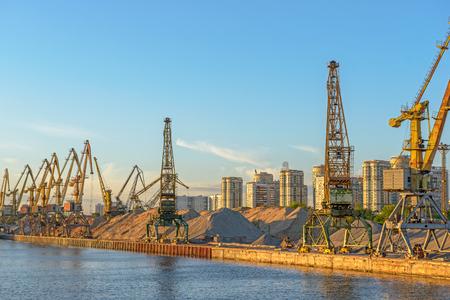 Cargo cranes in port terminal