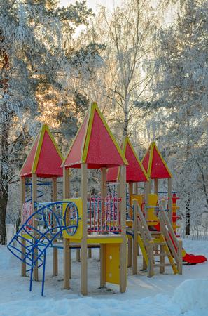 Winter park and playground on sunset light