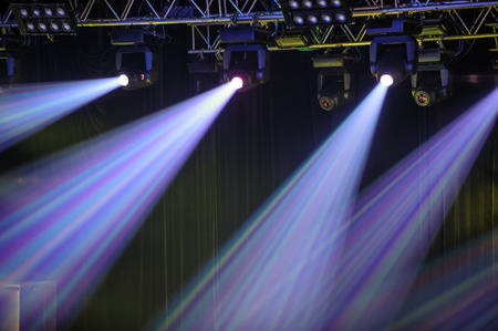 Stage spotlights hanging on lighting pipe systems