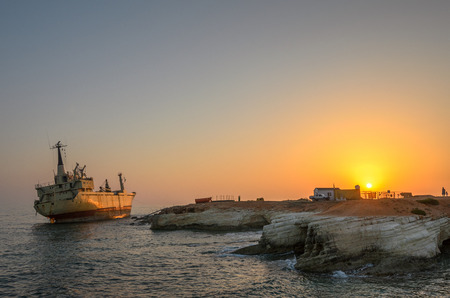 Cargo ship run aground on rocky coast Stock Photo