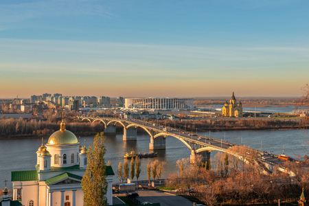 Cityscape and the bridge across Oka river in sunset light. Nizhny Novgorod, Russia