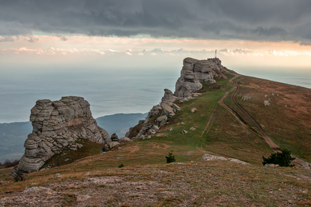 Rocky ledges on Demerdzhi mountain in Crimea on sunset light Stock Photo