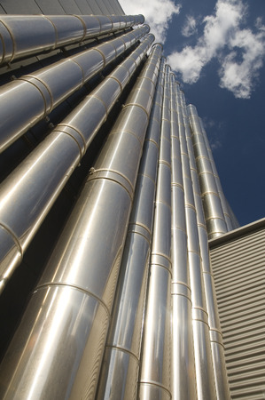 Metalic air-condition tubes of big office building. photo