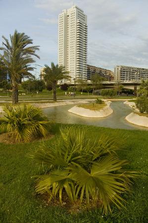 citypark: Citypark with skyscraper in the old channel of Turia river in Valencia.
