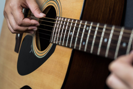 selective and blur focus musician playing folk guitar.concept for live music background.