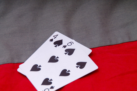 bet: Playing poker requires a bet.