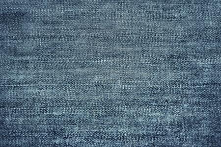 in jeans: la mezclilla azul es fondo Foto de archivo