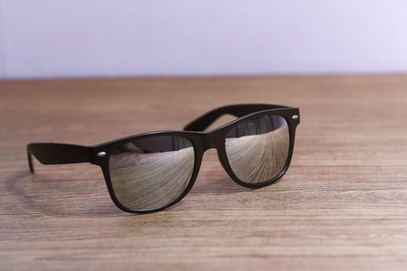 wayfarer: the sun glasses is the protection for the eye from lighting and sun Stock Photo