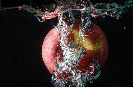 the fruit splash is apple in the water