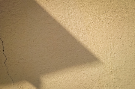 the light and shadow in cement wall Reklamní fotografie - 56600015