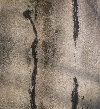 the light and shadow in cement wall Reklamní fotografie