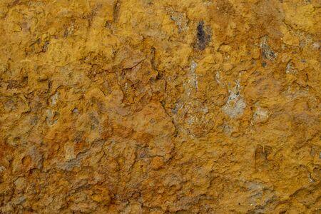 Texture of dry orange clay with cracks. Reklamní fotografie